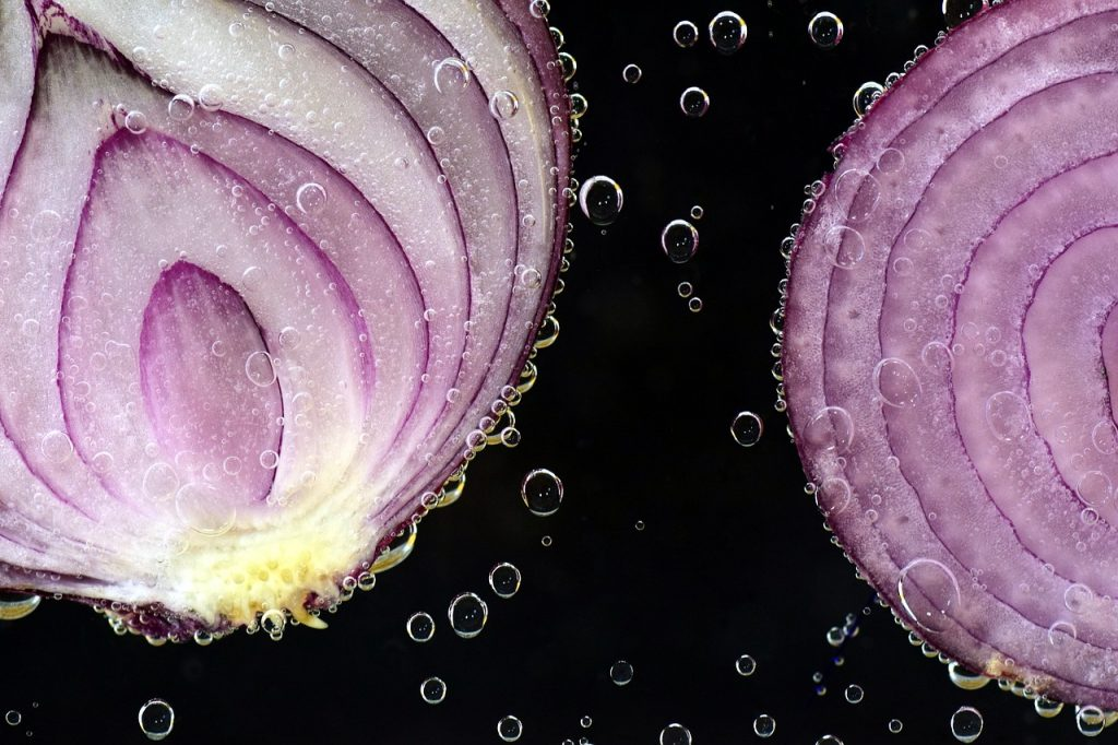 Photo of a sliced onion in water